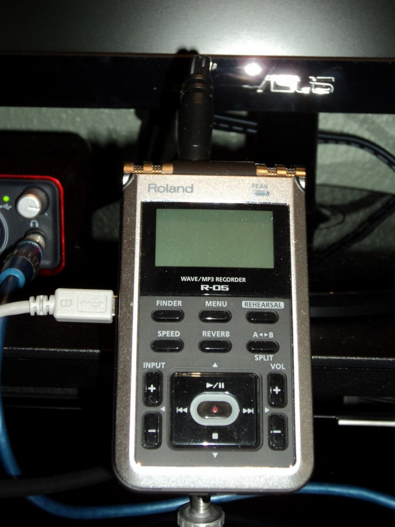 The Roland R-05 recorder is used in place of recording audio on the computer. I chose this because of the flexibility it gives me of being able to record audio from the computer, instead of using the computer to record audio coming from itself (if you know what I mean). Plus, I like the idea of being able to carry this to seminars with me for impromptu interviews.